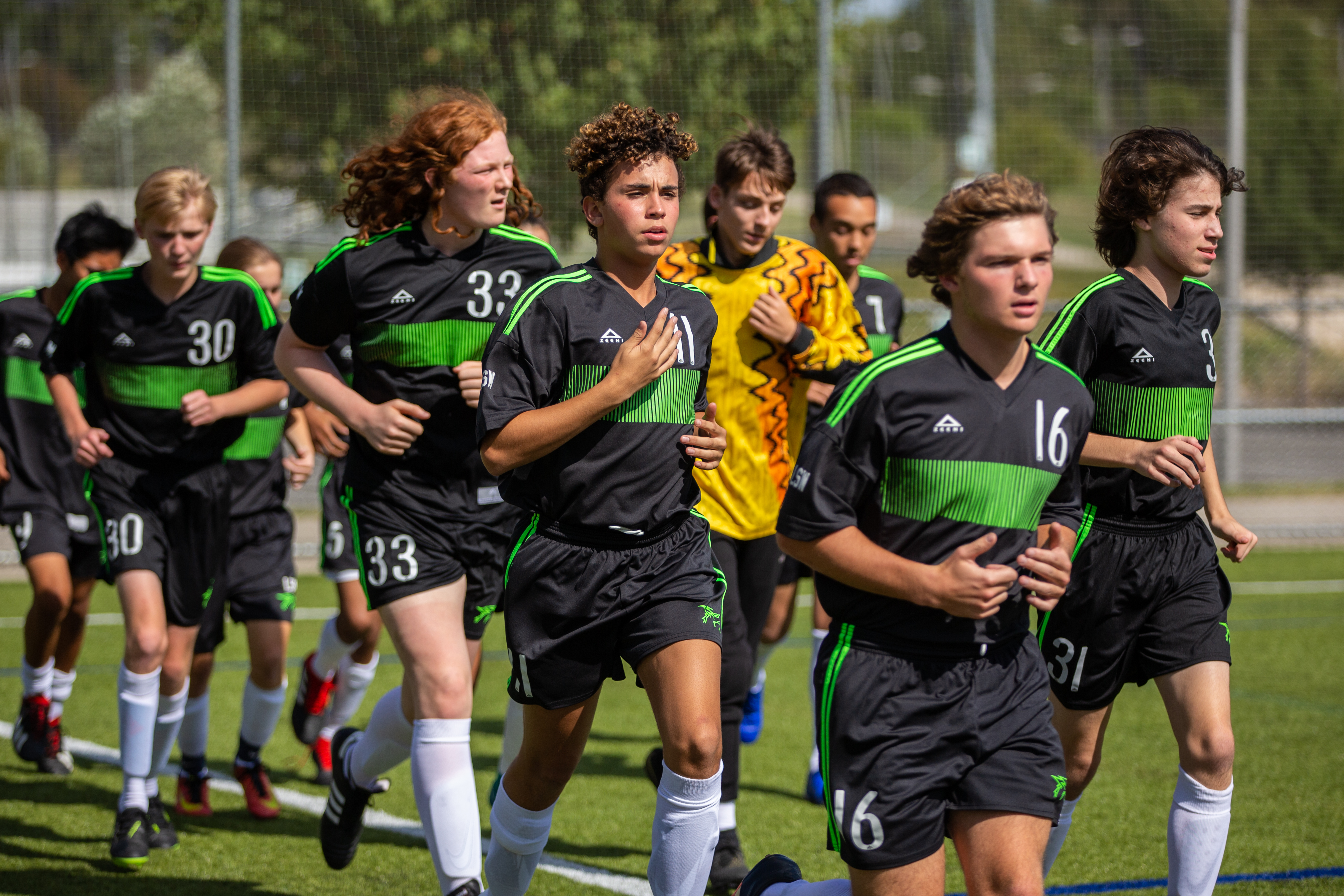 Soccer team running
