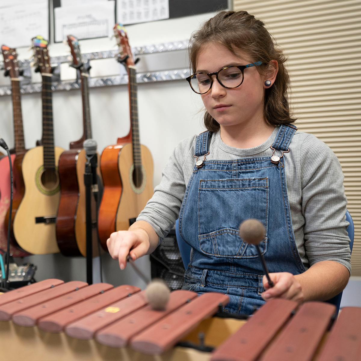 A student playing the xylophone.