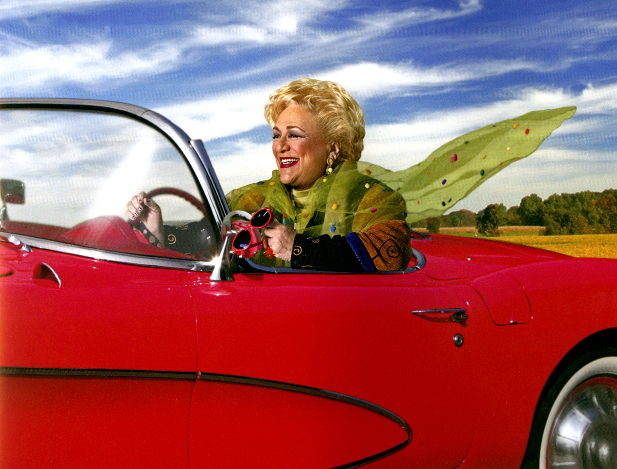 Sally Smith in red corvette