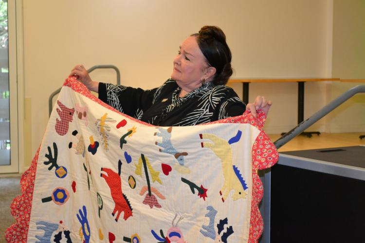 Patricia Polacco with quilt
