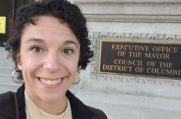 Melissa Wood takes selfie outside of DC Council offices