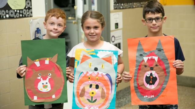 Elementary Students holding Art