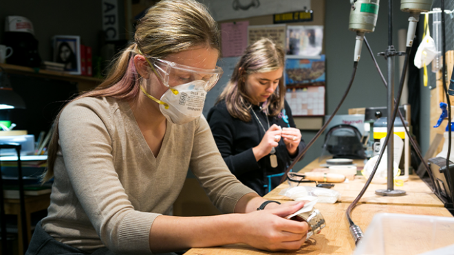 Two students at workshop bench in Metalsmith class