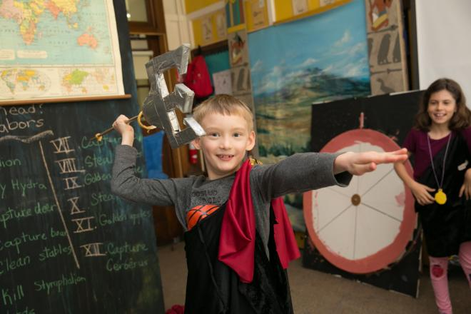 Student wields trident in gods and goddesses club