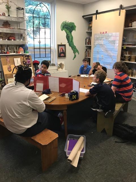 students and teacher playing dungeons and dragons